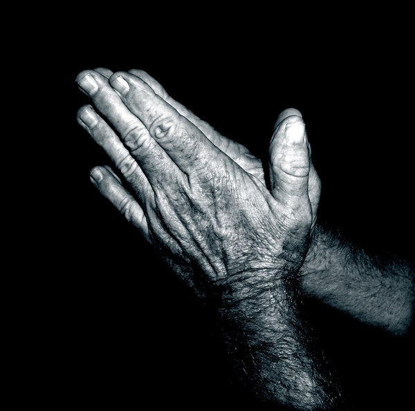 Praying Hands - Duotone: A man's hands together in prayer.