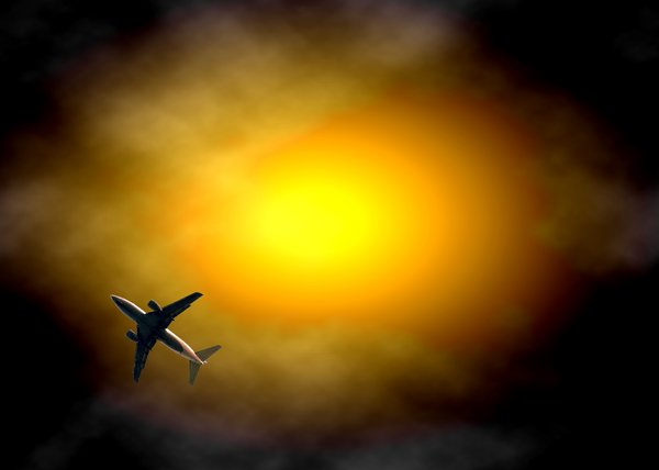 Plane in Sunset: Plane in spectacular sky that could be a storm or a sunset.