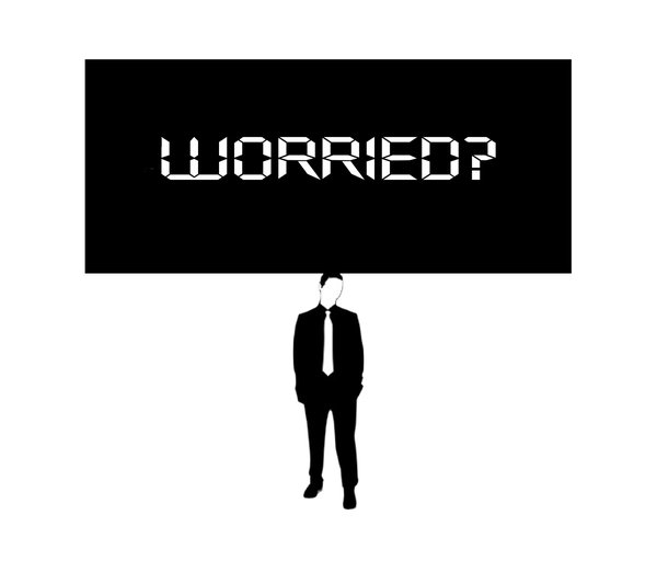 Something on Your Mind 1: Businessman (figure from a free for commercial use vector) with worrying thoughts weighing him down.