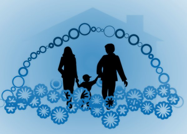Happy Family Happy Home 2: Silhouettes of a happy family with symbolic decorations and a house shape in the background. None of my images are to be redistributed. Silhouettes from Manfreid Klein - free to use commercially.