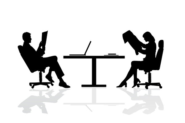 Business Table: Male and female business people at a desk