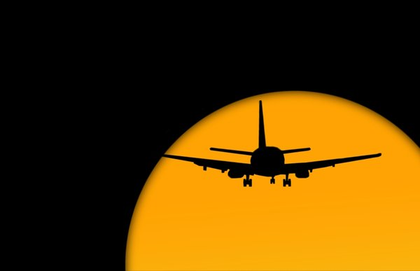 Jet Plane: Jet plane travel against a setting or rising sun