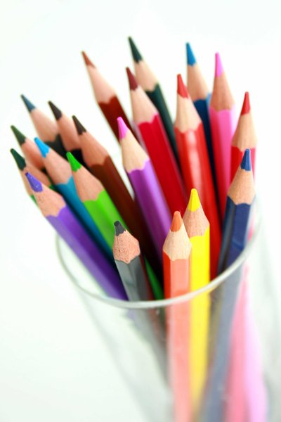 Pencils: Brightly coloured pencils in a glass container