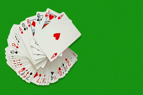 Card Pack: Pack of cards on green baize background with copyspace