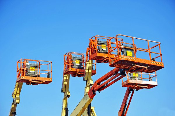Cherrypicker: Industrial cherrypicker's against a blue sky
