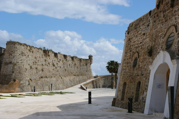 Ramparts: Murallas reales en Ceuta. Royal city walls of Ceuta and museum's door.
