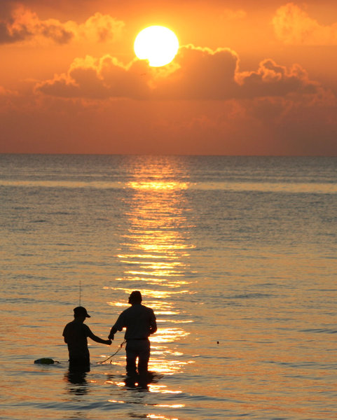 Father & Son at Sunrise: Father and son fishing at sunrise on 9-18-05-Galveston Bay, Texas