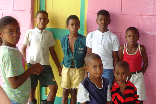 Dominican children 2: On a bus ride in Dominican Republic we trvelled through small villages and found many children like these looking and waiting for gifts of sweets etc. Quite poor villages but the children all seemed very happy.