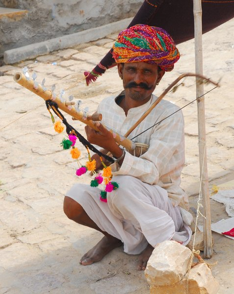 Incredible India: street musician playing his instrument. Jaisalmer, Rajastan, India