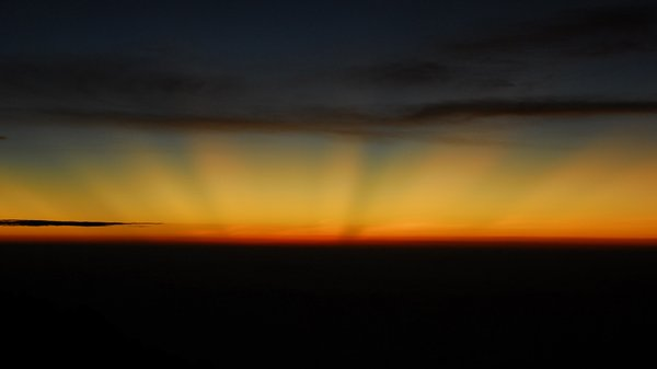 Sunrise on Kilimanjaro: Rising sun paint the sky and Kilimanjaro's glacier. 6 o'clock 5800m hight.