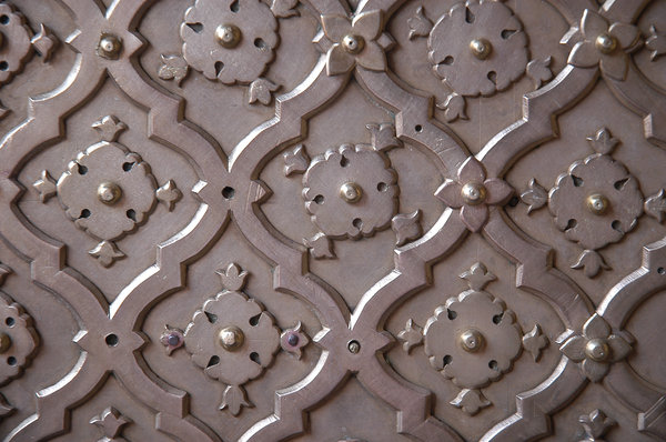 Metallic 1: A historic metallic panel on a door in City Palace, Jaipur, India.