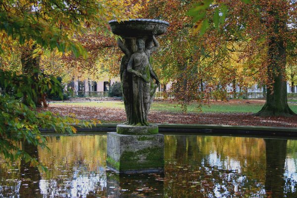 fountain in autumn: an old fountain in the park of Karlsruhe castle in autumn
