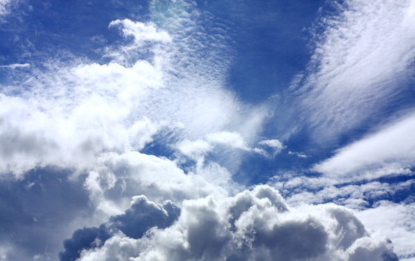 Blue and Cloudy Skies: Snapshots of a clear blue sky with white puffy clouds
