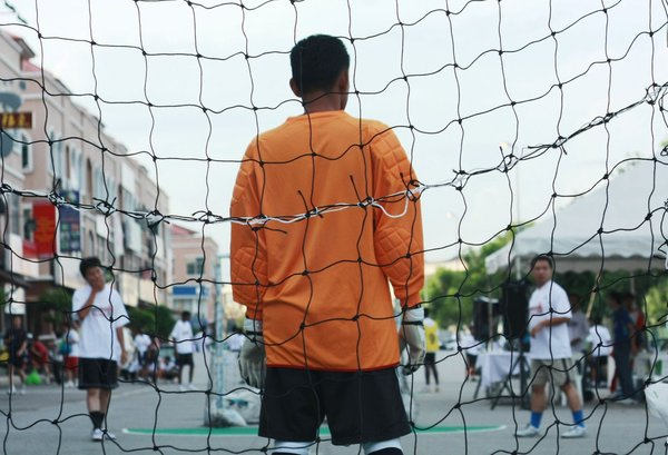 The Goalkeeper: Snapshot of a goalkeeper at a street futsal game