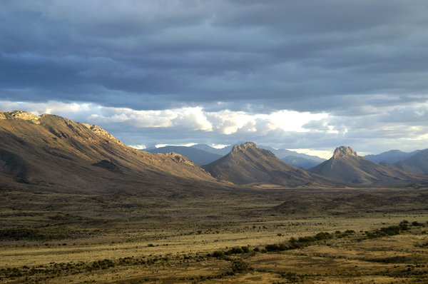 Ancient land: Karoo mountains and plains just West of Prince Albert.NB: Credit to read