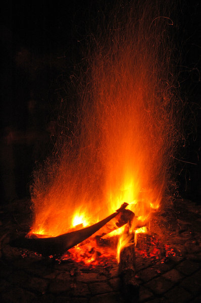 Squiggly fire sparks: Fire with rising sparks at night.NB: Credit to read