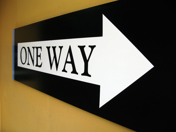 One Way: One way street sign.