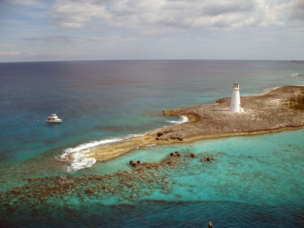 Lighthouse: Lighthouse and boat in the Bahamas.