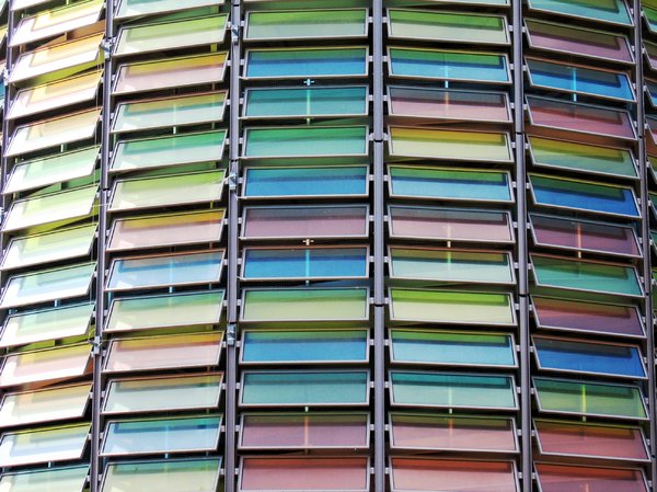 colourful windows: This is a car park stairway (well, I suppose there are no stairs in it) in Berlin