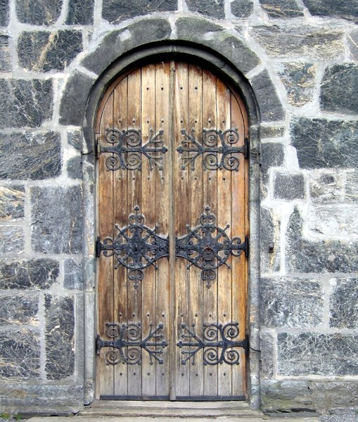 medieval wooden door: medieval wooden door on the Mariakirken, the oldest building in Bergen, Norway. Built 1140-70, restored 1853-75