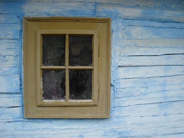 Window in wooden house: Window in wooden house from heritage park Vlkolinec, Slovakia