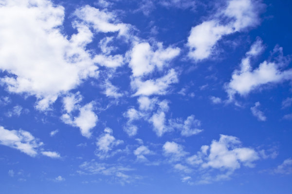 Fluffy Clouds: Fluffy clouds on a bright blue sky.