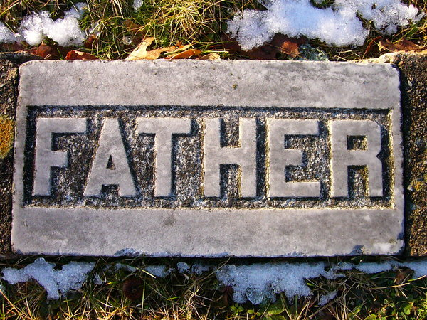 Father: Grave marker in an ancient cemetary across from a hill where lots of people were sliding on the snow in Kentville, Nova Scotia, Canada.