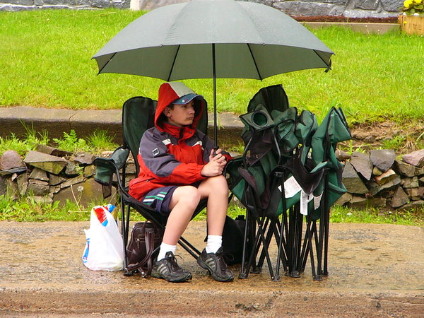 Alone in the rain: Rain falling on the Apple Blossom Parade, Kentville, Nova Scotia, Canada
