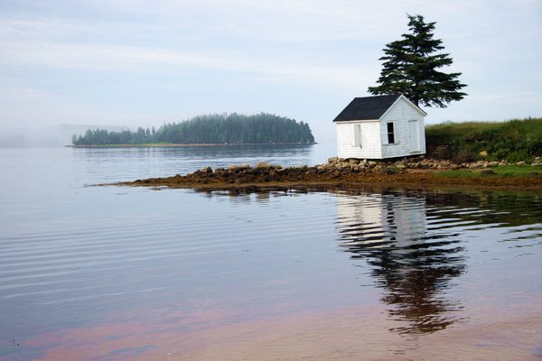 Life on the Edge: Shack by the sea near Chester, Nova Scotia, Canada early in the morning.