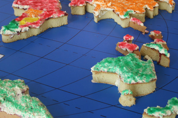 cake world: part of world map made and cut from cake and decorated