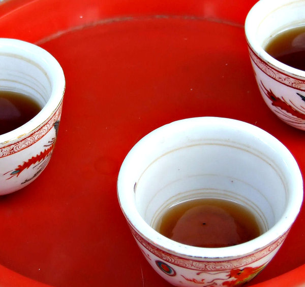 T for 3: Chinese tea in small cups on red tray