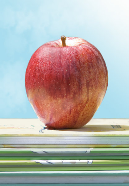 Back to school: apple on books