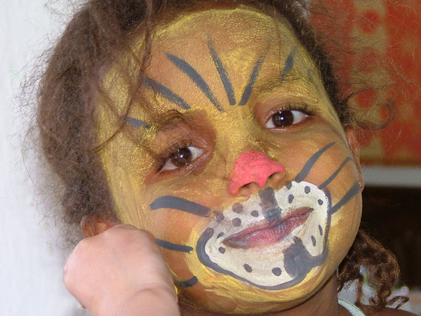 Face Painting: My niece having some fun with face paints
