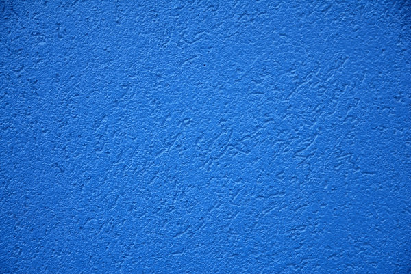 Blue Stucco: A blue stucco wall.