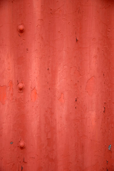 Corrugated Metal: Red corrugated metal.