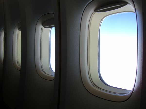 Aircraft Interior: View from within a 747-400 at high altitude over Australia.
