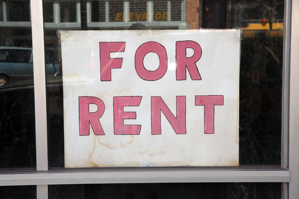 For Rent: A for rent sign in a store window.