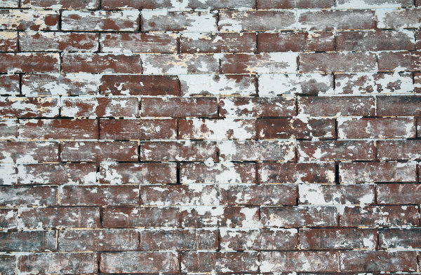 Brick: A painted brick wall.