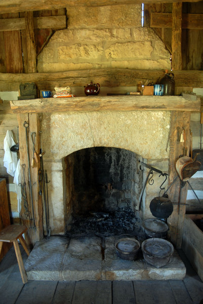 Fireplace: A fireplace in a log cabin.
