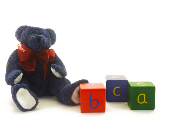 ABC Teddy: Blue teddybear with wooden RGB alpha blocks.