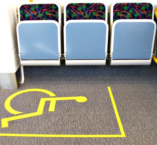 wheel chair seating: wheel chair access and seating area on suburban train