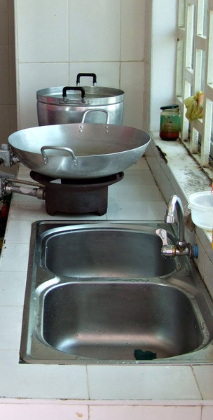 ready to cook and clean: cooking with gas on sink bench in small kitchen