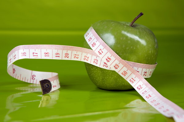 perfect figure: apple with centimeter,greenbackground