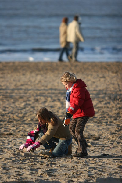 playing on the beach: playing family  on the beach