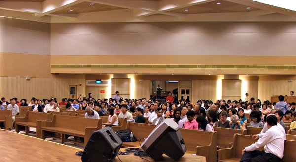 meeting readiness: members of church congregation ready for meeting to start in Singapore church