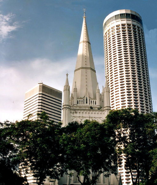 highrise comparison: modern highrise buildings in comparison to cathedral spire's tallness in Singapore