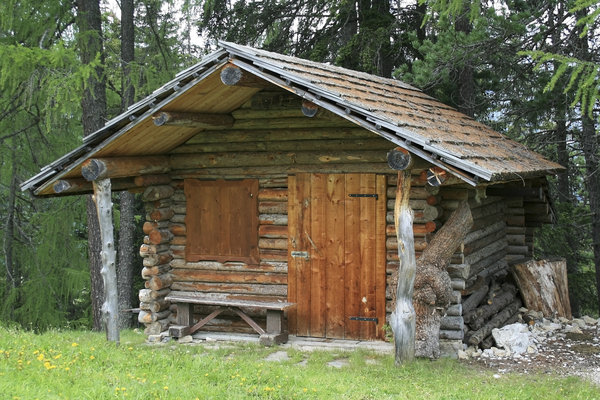 Alpine log cabin: A log cabin in the Alps.