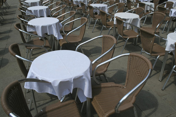 Cafe tables: Tables and chairs at a pavement cafe in Italy.