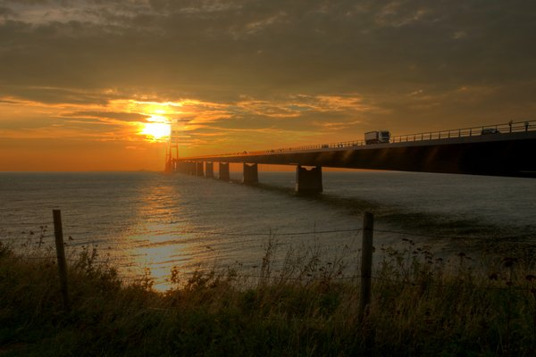 Bridge in sunset - HDR: The Great Belt Bridge in Denmark in autumn sunset. The picture is HDR.