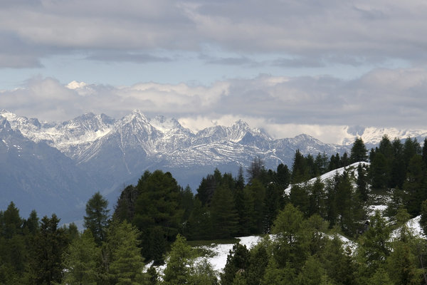 Distant white mountains: The Dolomite mountains, Italy, in June after an unusually late snowfall.